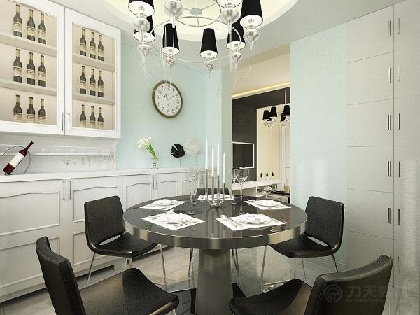边上是酒柜。接下来是客厅,客厅的吊顶是采用与影视墙融为一体的造型,周围加灯带装饰,美观大方。L型沙发的组个很适合这个空间。