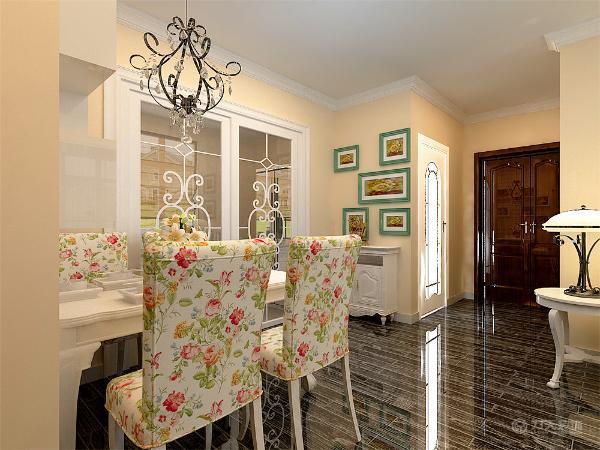 餐厅的设计采用白色的餐桌以及花色的布纹进行装饰,餐厅的背景墙在设计成方格的空间,厨房的设计采用白色的橱柜进行装饰