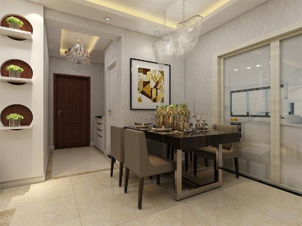 餐厅放置了一套四人式的餐桌,厨房放置了一个橱柜组合,将洗菜池镶嵌到里面,放置在窗口位置,橱柜的另一面安置灶台。