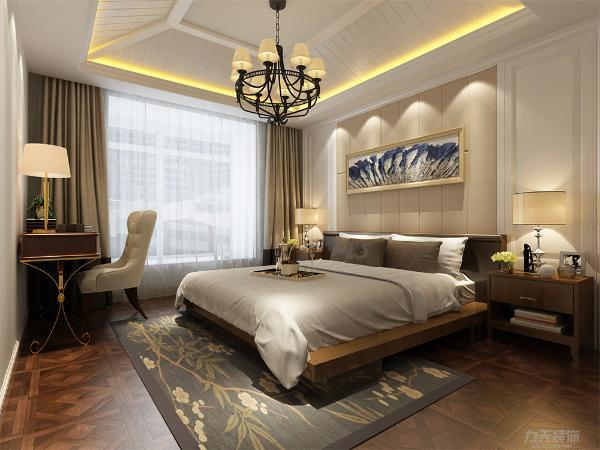 卧室的设计很舒适,吊顶的设计为石膏板拉缝并藏有灯带,家具的选择较为简单,卧室的设计舒适典雅,家具的选择为深木色,整体设计很舒适,适合居住。