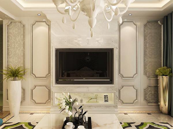 客厅的电视背景墙由石材和石膏板组成,电视背景墙的中间做了假墙,由石材包裹,电视剧放进凹槽内,最下面的相当于一个电视柜,两边用石膏线圈边,里面贴了欧式壁纸,为了不显两边空荡,在两边放了绿植