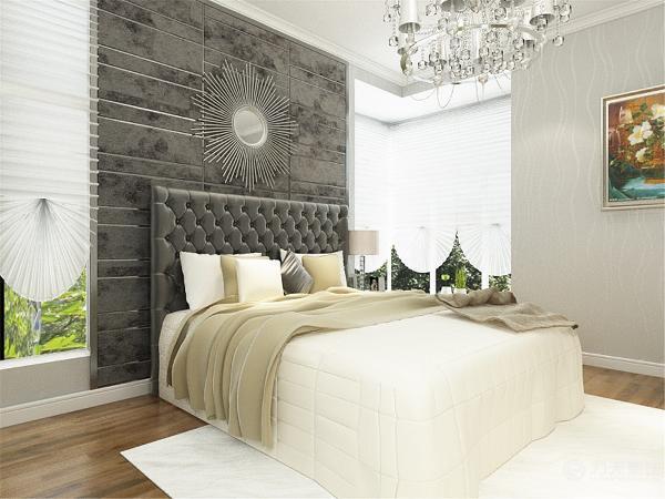 次卧室也兼备了书房的功能,沙发选用的是沙发床,地面顶面与主卧是相同墙面是深灰色的壁纸。