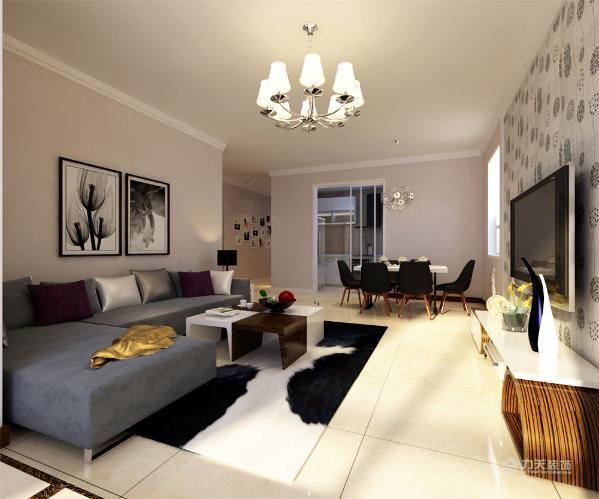 在平面布局上强调空间的自然融合。客厅空间讲究精巧丰富,奶咖色墙面让整个空间更加丰富多彩,客厅地面通铺800*800的米黄色地砖