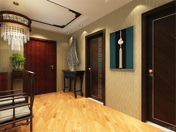 客厅的吊顶回型石膏板排列的造型,凸显出端庄大气的氛围。茶几和沙发还有电视柜都采用了优质的木制材料。