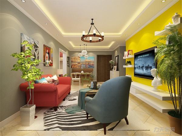 电视背景墙采用DIY电视柜组合,时尚又实用,墙面是整体黄色。沙发背景墙用两个油画来装饰,增强整个空间的文化气息。