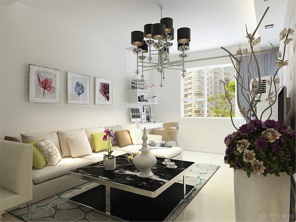白色L型的沙发配以黑色简单的茶几与3幅简单的挂画形成的影视墙成为了一组画面。彰显干净整洁。