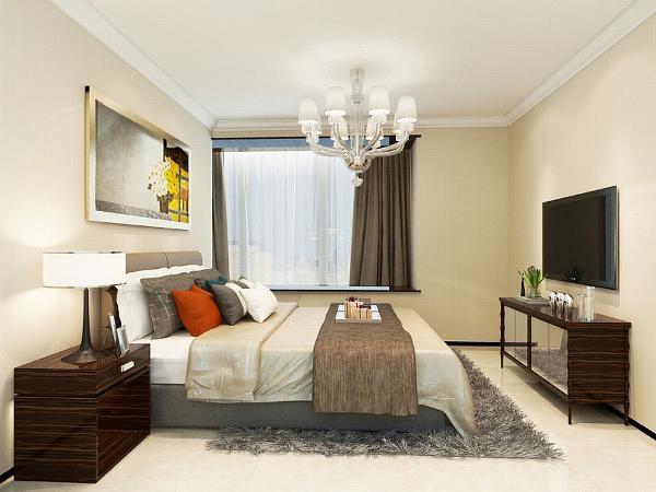 主卧室地面采用600*600米色的瓷砖正铺,给人一种干净舒适的感觉。墙面使用浅黄色壁纸。搭配上暖黄色的灯光,让人感觉到温馨。整体打造了一个让人舒适的休息空间。