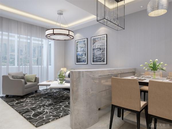 餐厅与客厅使用大理石吧台做隔断,餐厅上方使用回型吊顶加上发光灯饰,背景墙使用简单的挂画装饰。