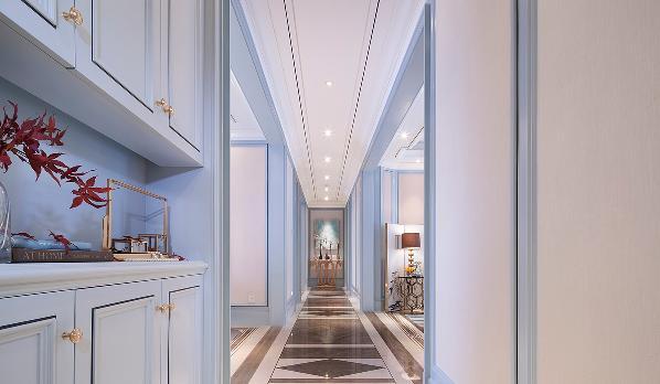 房子本身格局还算方正,但是走廊过长,缺乏了真正的实用性,而且没有一个具体的空间区分,设计师在业主的要求下进行了稍微的改造,使使其功能区域更为完备。布局更为合理,更加的有空间感。