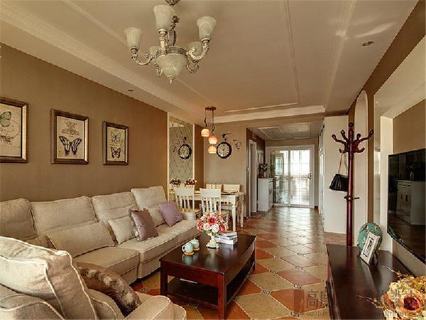 客厅整体墙面大胆采用高饱和的暖灰色调为主,加上家具的颜色使整个空间 整体而统一.