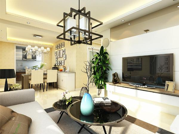 客厅采用了明朗简约的线条,把餐厅和客厅进行了空间划分,壁纸和灯光采用了暖黄色。墙上采用了几幅简单的画框进行了装饰。