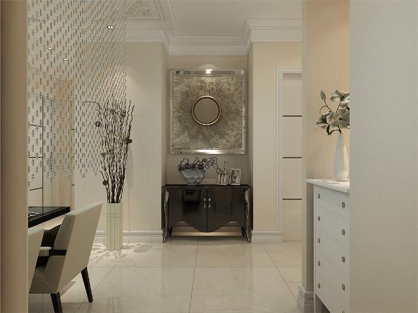 入户门处搭配一款白色鞋柜,正对着入户门处放置了一个边柜,柜子上方挂了一幅装饰挂画。