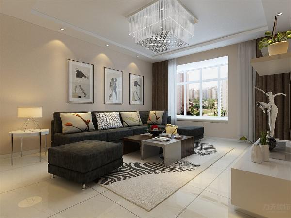 客厅在家具配置上,深灰色的沙发,与花色抱枕的搭配,使家具倍感时尚,具有舒适与美观并存的享受。