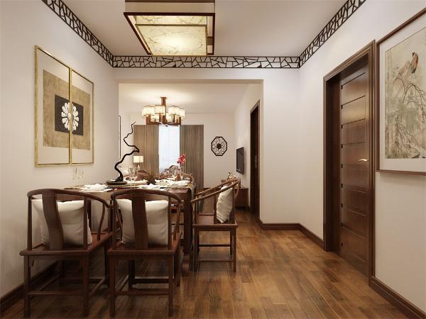 客厅的对面是一餐厅,餐厅与客厅相对。厨房、餐厅也是运用深色木纹的桌子,椅子和柜子,具有整体性。