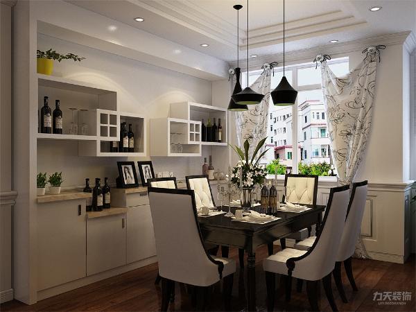 餐厅采用了六人桌椅,还有一个很有设计感的酒柜,餐厅的吊顶为叠加的样式,使空间更有层次感,因家具和酒柜从颜色到样式都很死板。