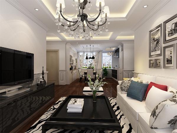 厅采用了黑白灰为主色调,加入其他的颜色进行搭配,使空间不暗沉,很有活力,家具的选择是以硬线条为主,简单大方,抱枕的颜色采用了大胆的红,绿,黄,使空间更加舒适。
