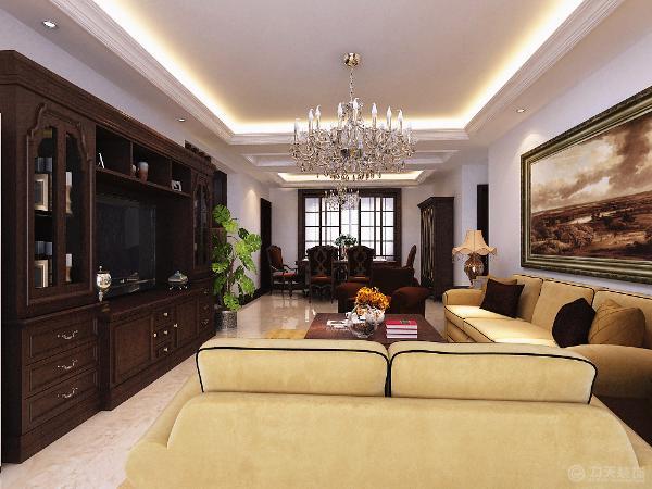 非凡的气度选择新古典深红色的柜子嵌入电视既省去了电视背景墙的装饰又增加了储物空间,也点亮了新古典风格的主题,客厅选择六人餐桌和水晶吊灯,简单大方又不失奢华,