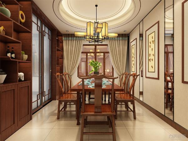 餐厅背景用画和小块的镜面来装饰,这样可以使餐厅空间看起来更大一些,和厨房连通的墙面用柜子来修饰,不仅可以储物,而且更为美观。