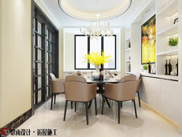餐厅采用圆桌和圆形吊顶,相呼应,大面积的餐边柜增加了储物面积,展示功能体现房主品味,在灯光的渲染下,让用餐感受都变的更加清新。