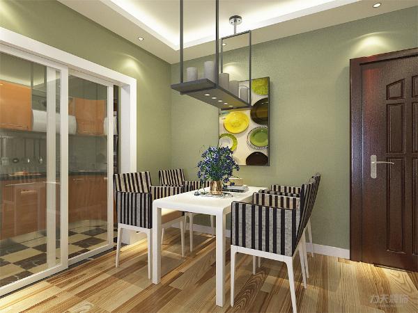 餐桌的墙体一面放置艺术画,装饰空间。整体空间吊顶采用石膏板回字形吊顶造型,增强空间点线面的完美结合,使空间很大方,富有节奏韵律。