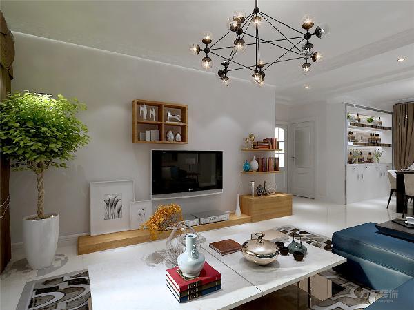 整体的设计方案主要采用较为暖的色调为主,较多用的白色等,在沙发背景墙上点缀了彩色照片墙的元素,在建筑装饰上利用了空间性、创造性的饰物展现了现代主义简洁造型、无过多的装饰、推崇科学合理的构造工艺的特点。