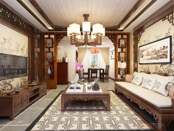 客厅整体家具传统中式风格,客厅与餐厅的衔接运用的月亮门的装饰柜显得空间更有层次感 运用传统古典的家具,设计上也不忘为新中式添以这厚重的一笔