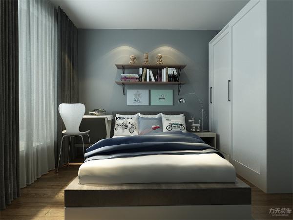 次卧采用较为灰色系的装饰风格,来呼应客厅的工业风风格,从整体的设计风格来说,这是一个具有特色,又有家的感觉的一个设计,
