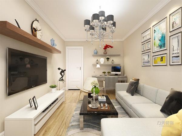 客厅采用的是米坨色的乳胶漆从细节上看,在电视背景墙的装饰上,采用的是装饰摆架,表现了一种现代气息感,在沙发的背景墙的设计上,采用的是挂画形式,抱枕的选用上,运用相同颜色来点缀