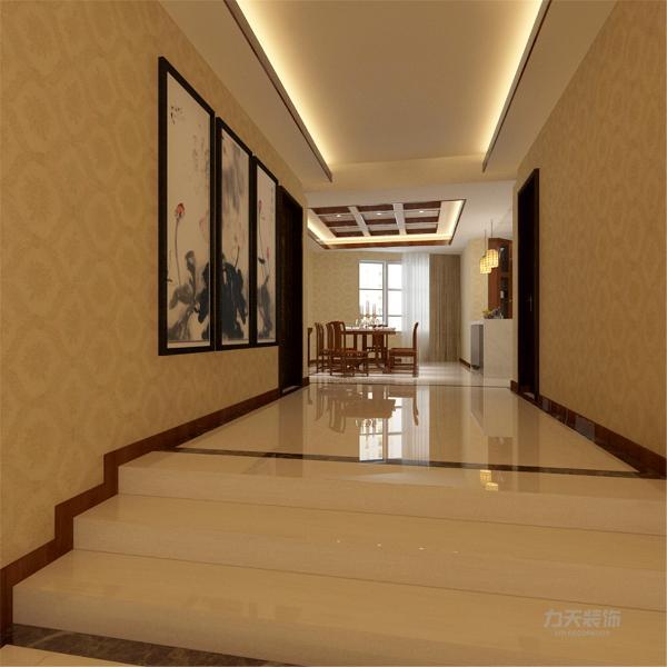 此处玄关是一进门的玄关由于户型比较大所以进门的玄关比较宽敞明亮设计了一个台阶的方式彰显了一进门大气的感觉并且还有水墨画的设置和中式风格相呼应