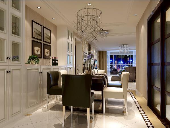 餐厅延续客厅的设计手法,黑白相间搭配的餐桌椅作为空间的主体,充满时尚前卫金属气息的吊灯成为餐厅的一大亮点,在精致垂灯的搭配下形成很好的就餐氛围