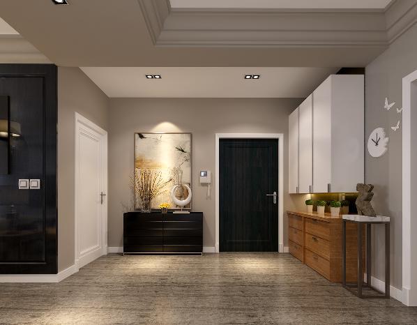 门厅与整体风格一致,采用黑胡桃的出行矮柜,而柜脚却用不锈钢金属点缀出现代气息。柜体上的挂画采用具有中式韵味的题材,更加凸显了主人的文化气息。