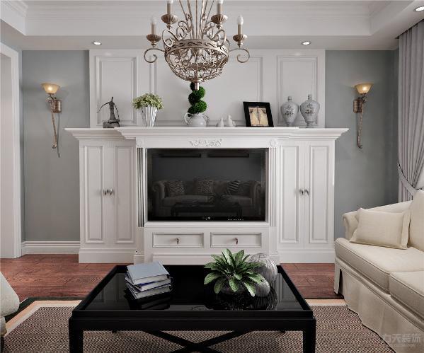 客厅整体设计高雅格调,淡淡的蓝色增添了室内的暖意,营造温馨的乡村风景。大马士革的花布映衬黑色的沙发,色彩丰富的水果给人以视觉美感,享受家的温暖与舒畅。