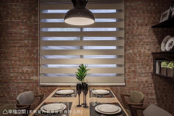 利用红砖墙的质朴况味,加上北欧感的灯饰与家具,成为绝佳的视觉引导与端景。