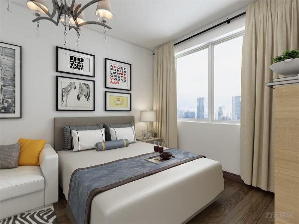 主卧色调和客餐厅一致,床头用简单的装饰画来点缀,既美观又实用。浅色的家具,简洁的线条。整体的色调搭配,让人得到彻底放松。