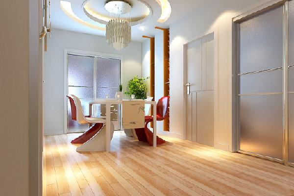 餐厅的空间比较宽敞,所以在顶面做了一个圆圈式比较有动感的吊顶,让他跟餐桌相呼应,餐桌椅也是比较有现代感的红色与白色的结合,跟整个空间的元素相结合。