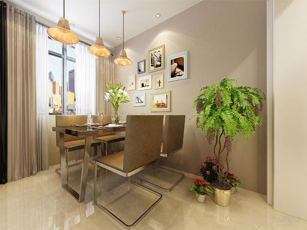 餐厅设计中,采用的不锈钢桌子搭配,在餐桌背景上采用的是挂画的形式,灯具采用的是吊灯,地面采用的是浅色地砖,打造一种现代美感。