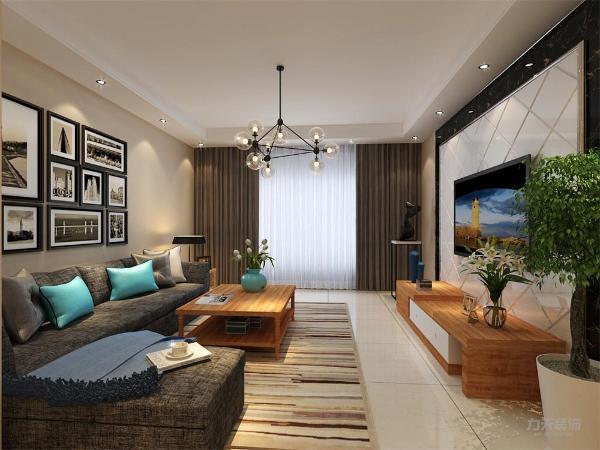 客厅的背景墙用的瓷砖斜加上黑色亚克力,既简单但又不失品味,沙发选用的是灰色的加上现代感十足的挂画,装饰性强,现代感的金属吊灯,烘托出现代时尚个性的气息