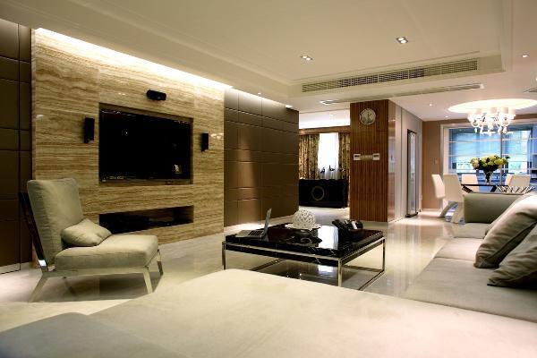 客厅背景墙的设计采用的是理石加软包的手法,软硬相结合,同时很好的划分了空间,在色彩上,采用中色系,整体整齐划一,庄重大方。
