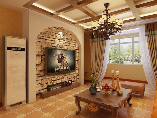 客厅和餐厅贴满浅黄色圆形花纹壁纸,客厅吊顶采用回字形,镶嵌方格形实木板,中间的吊灯凸显地中海风格特点,地面铺满仿古瓷砖