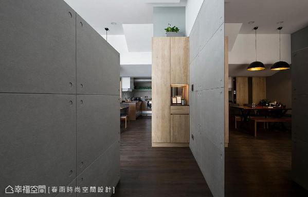 特意设半身矮墙区隔玄关与客厅空间,也顺势成为电视主墙的基座。