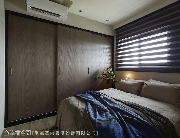 整面木作衣柜,以强大的收纳机能,为主卧空间提供视觉上收繁于简的宽敞效果。