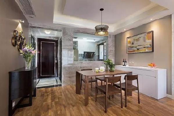 玻璃的设计,增强了餐厅与厨房的互动感,坐在餐厅,就可以看到厨房女主人忙碌的身影。在仿大理石纹路的高级灰瓷砖的陪衬下,现代家具更显时尚气息。