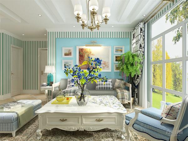 客餐厅隔着一条走廊,空间都比较适中,餐桌的靠墙面放了一个小型的餐具柜来增加功能性增强空间的容纳效果和氛围。客厅的背景墙是用地中海经典的蓝色来承托气氛,在加上一个大型的落地窗,使得空间变大。