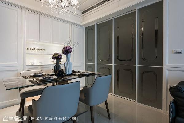 林妤如设计师依照屋主的实际需求,于餐厅设置线板造型的收纳餐柜,勾勒居者的品味及生活点滴。
