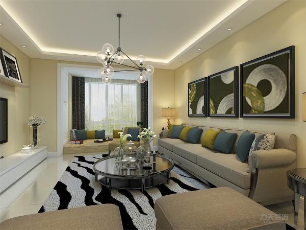 客厅的设计中,沙发背景墙用简单的挂画做装饰,电视墙做了简单的壁挂式置物板。阳台区做了榻榻米的设计。