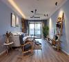 客厅墙面刷成了纯净沉稳的浅蓝色,带来一种安全感,使人产生安静放松的感觉,木制家具保留了原始的纹路,更加贴近大自然