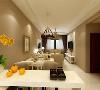 吊顶的设计很简单,没有太多的造型,做了一圈边顶,装上筒灯,瞬间整个空间神秘莫测,给人已无线的遐想,沙发的选择为布艺沙发,突显出整体的设计简约舒适。