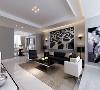 白色的单人位沙发与整个空间形成了鲜明的黑白搭配。