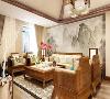 在整个装饰中多采用了实木作为空间风格的定位。在空间的设计中首先客厅是着重表现的,在客厅的设计上我们采用了水墨画这一中式元素作与木元素相结合作为沙发电视墙。