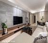 在纵长型的空间基地上,以柜体造型、大理石墙和各式家具,划分出不同的场域段落。